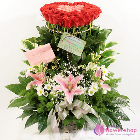 Basket of red roses mixed pink lily