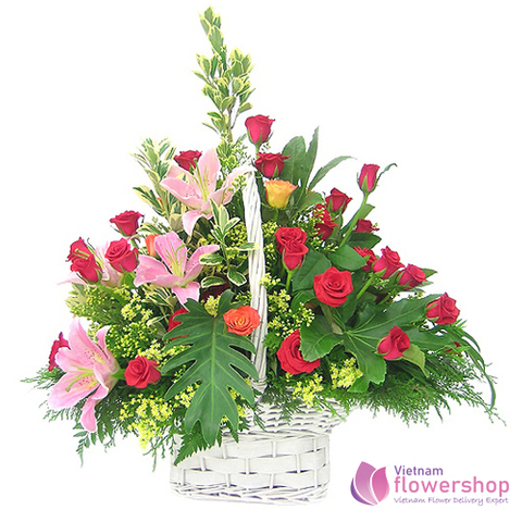 Red roses mixed pink lilies arrangement