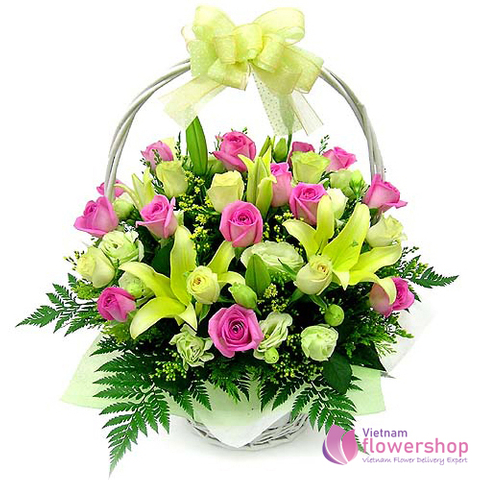 Basket of pink roses mixed yellow lilies